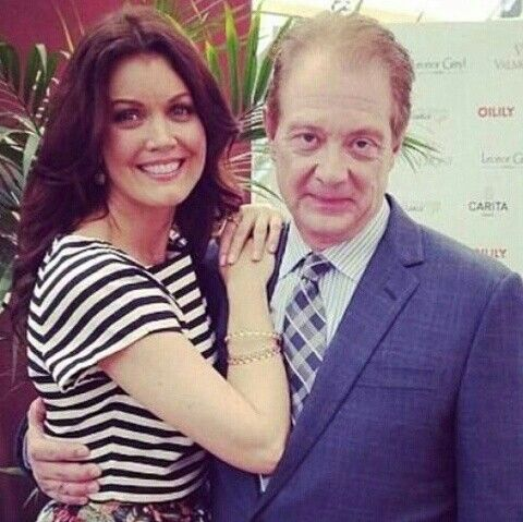 Bellamy Young (Mellie Grant) and Jeff Perry (Cyrus Beene) on the set of Scandal.
