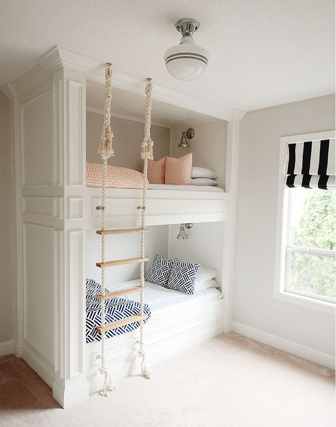 How adorable is this girls bedroom?! Stacked bunk beds with printed  bedding, crown