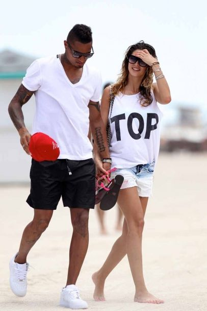 AC Milan midfielder Kevin Prince Boateng and girlfriend Melissa Satta at the beach in Miami Beach, FL. Melissa, an Italian showgirl, wore a florescent green bikini on her beach outing. The couple arrived hours before from New York City, and went straight to the beach.