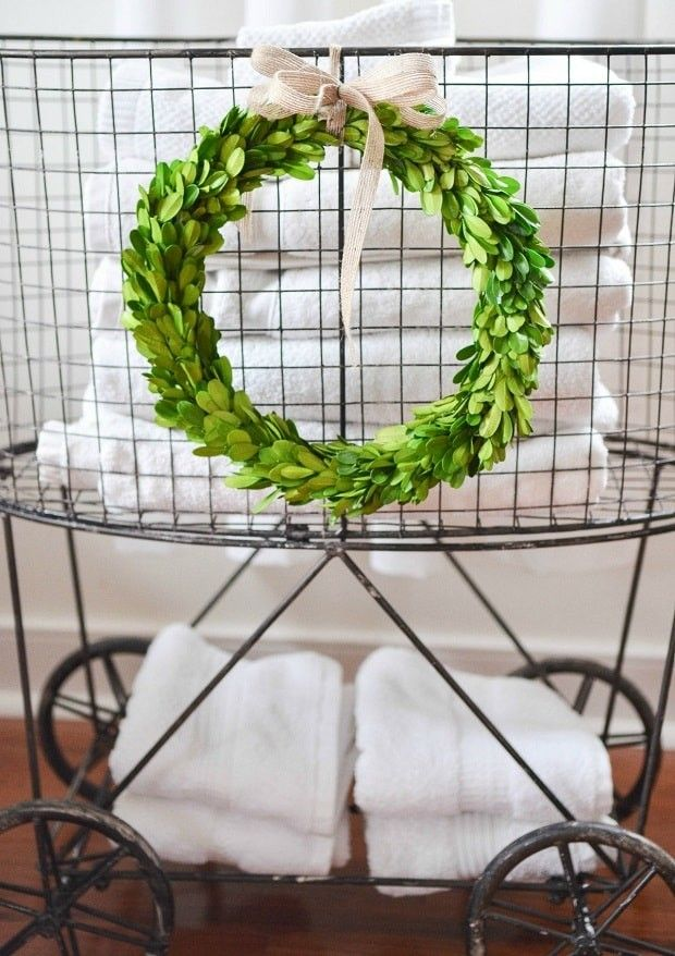 Vintage inspired metal laundry basket with wheels from Antique Farmhouse; so cute in the laundry room, bathroom, or even holding presents under the Christmas tree!                                                                                                                                                                                 More