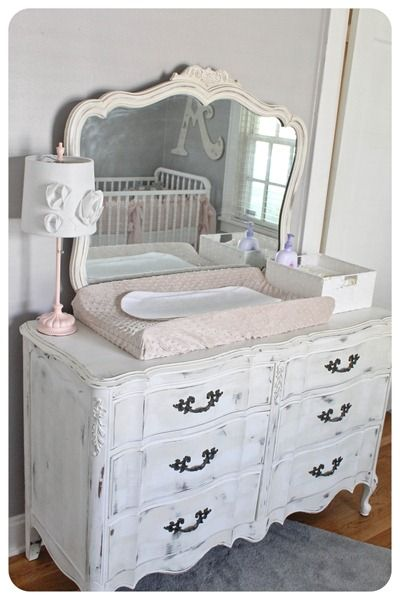 old dresser as changing table in baby girl room