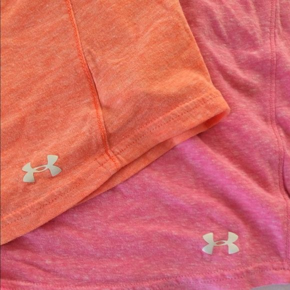 Bundle Under Armour tanks Pink/ orange under armour tanks. Cotton, breathable. Racer back athletic for. Looser in waist Under Armour Tops