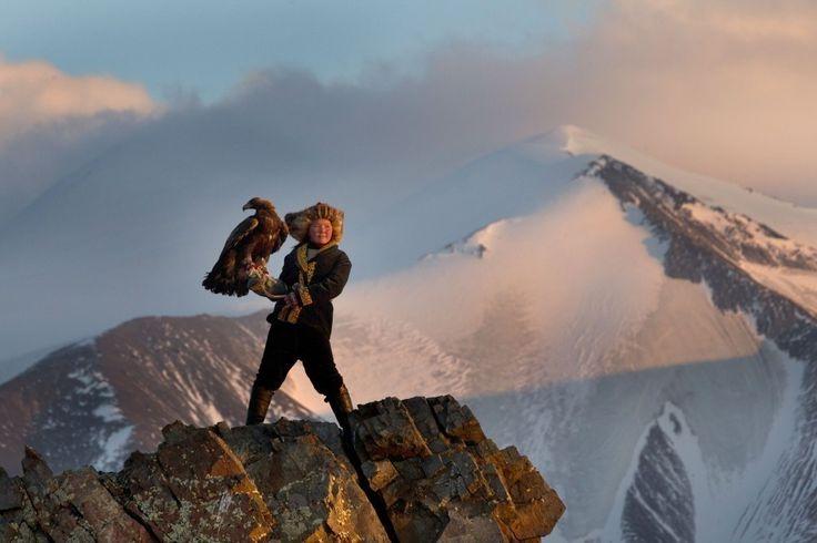 13-year-old eagle huntress Ashol Pan in Mongolia.