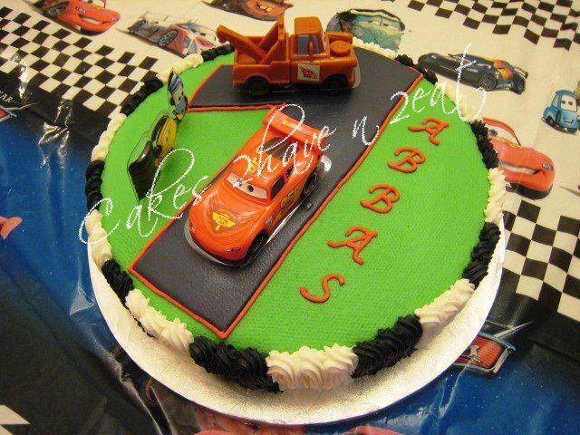 """CARS CAKE - VANILLA CAKE BEAUTIFULLY DECORATED IN BUTTERCREAM ICING FOR AN AMAZING NEPHEW TURNING ''ONE""""."""
