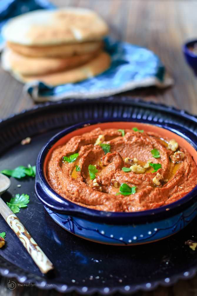 Muhammara Recipe (Roasted Red Pepper Dip)   The Mediterranean Dish. A hearty vegan dip with roasted red peppers and walnuts with a splash of pomegranate molasses and Mediterranean spices. See the step-by-step tutorial on TheMediterraneanDish.com
