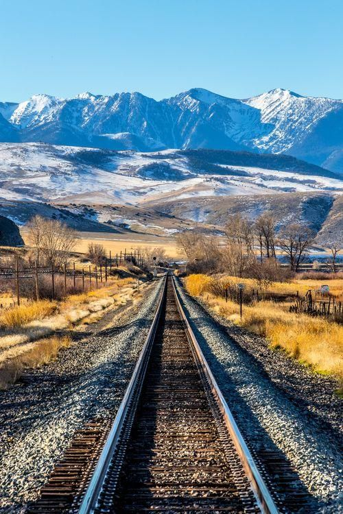 Tracks to the Mountains Photo by Andy Austin — National Geographic Your Shot << reminds me of the train tracks from Spirit!!