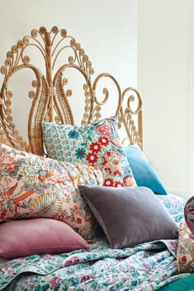 SHABBY CHIC KALEIDOSCOPE OF COLOR LINENS AND PILLOWS. Natural Wicker Headboard | World Market
