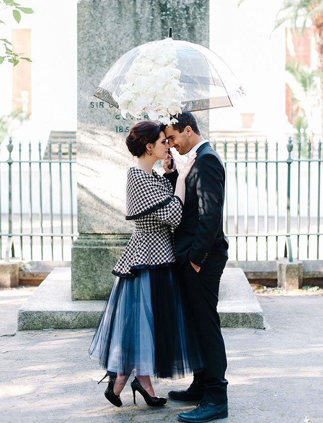 Italian Vogue-inspired Elopement -- love the floral decorated umbrella!