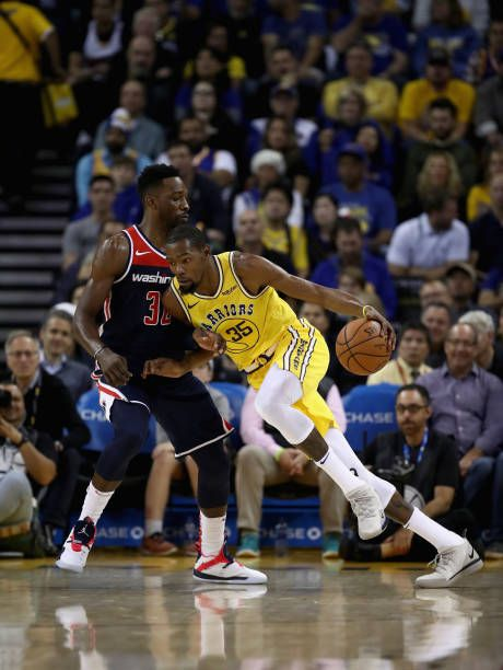 44da7ef9bf1 Kevin Durant of the Golden State Warriors drives on Jeff Green of the Washington  Wizards at ORACLE Arena on October 24 2018 in Oakland California.