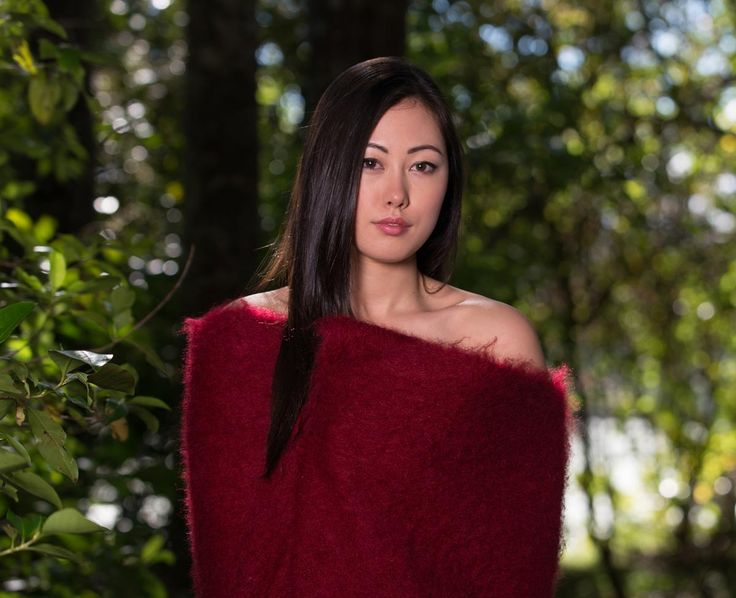 A beautiful lady in a beautiful deep red mohair blanket by Gorgeous Creatures.