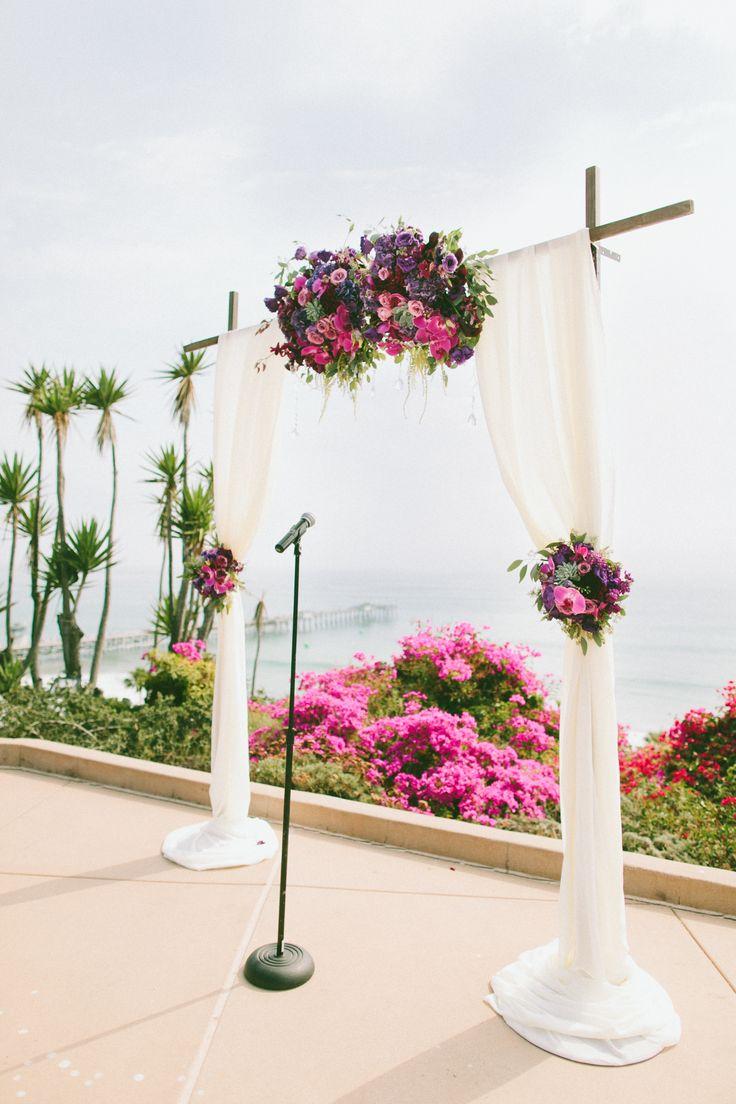 beach weddings in orange county ca%0A Ceremony wedding arc Purple flowers and draping fabric  Casa Romantica   San Clemente