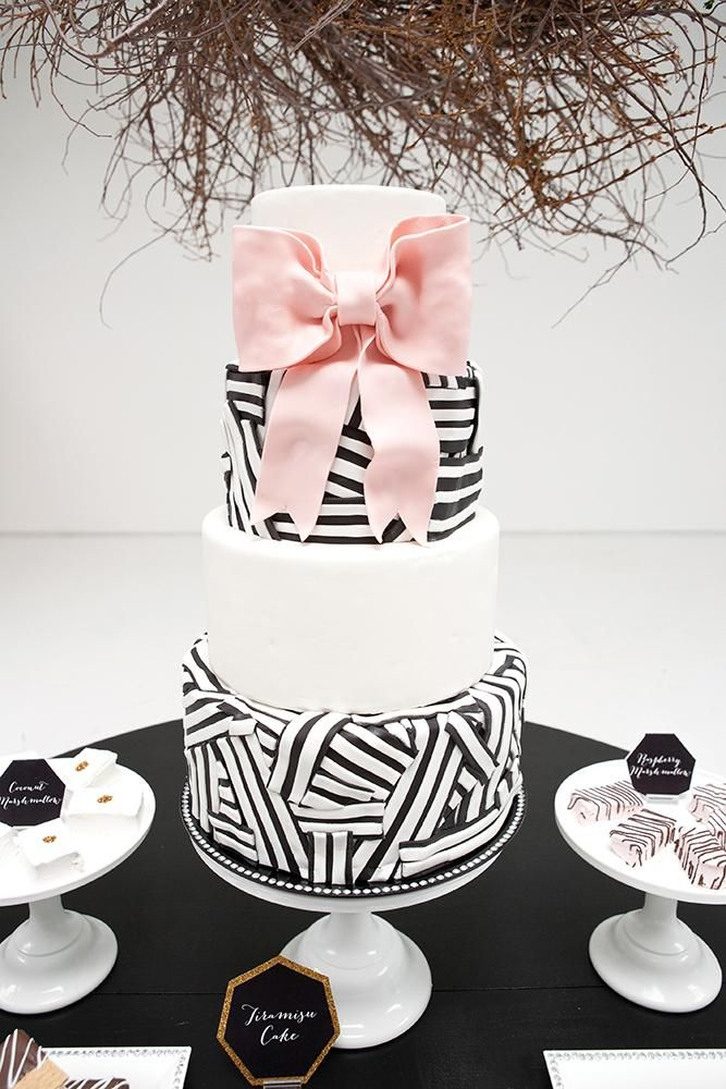 modern black and white bow graphical cake with pink ribbon.