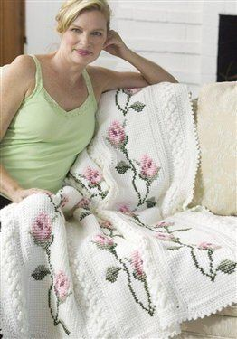 Very pretty Tunisian crochet throw for the experienced crocheter with cross stitched flowers. ~ I just bought the yarn to make this afghan...I love it!