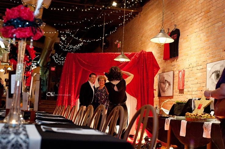 RED: A Vintage Hollywood Event at Downtown Toledo's Grumpy's. The decor was set up and created by Heather and her team at ComplEvents. I love being asked by Heather and her clients at Adam Cufr - Fourth Dimension Financial Group to capture their events for them. What a wonderful atmosphere at Grumpy's! Also as a highlight for the evening, an authentic big Band singer....amazing voice!  Party favors, chocolate covered pretzels wrapped like cigars  Matt Walch singing the Big Band Standards
