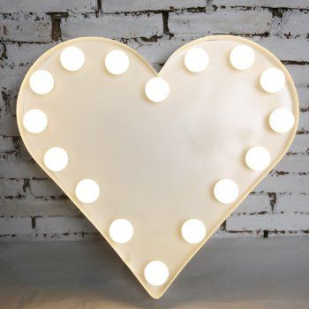 Ok, this isn't quite a letter but we love how classic this heart shape is. Using white lights instead of clear ones adds another layer of definition in the design. #festoonlights #fairylights