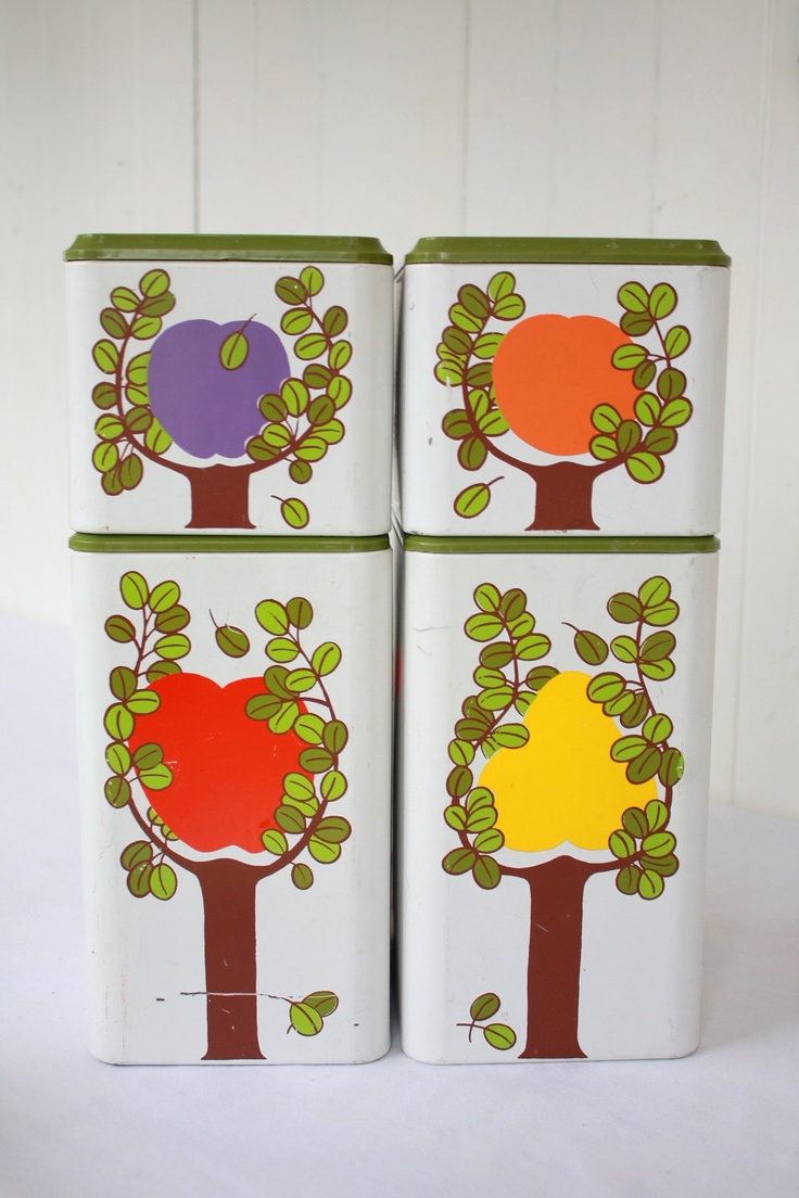Vintage Canisters Set of 4 Metal Colorful Fruit Tree Retro Kitschy 1960s Square Stackable No Labels. $18.00, via Etsy.