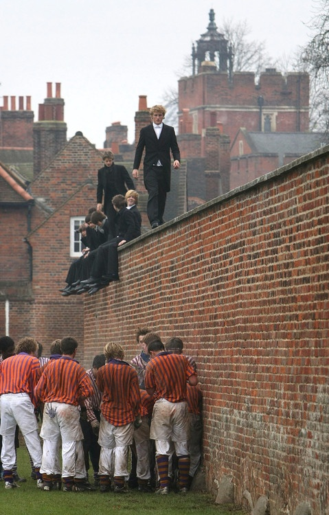 "Eton College students at the annual ""Wall Game,"" akin to a perpetual rugby scrum; the first recorded game was played in 1766."