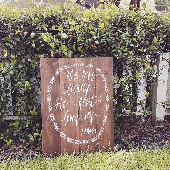 Our beautiful We Love Because He First Loved Us sign makes a wonderful addition to your wedding or home. You can embellish it with flowers or prop