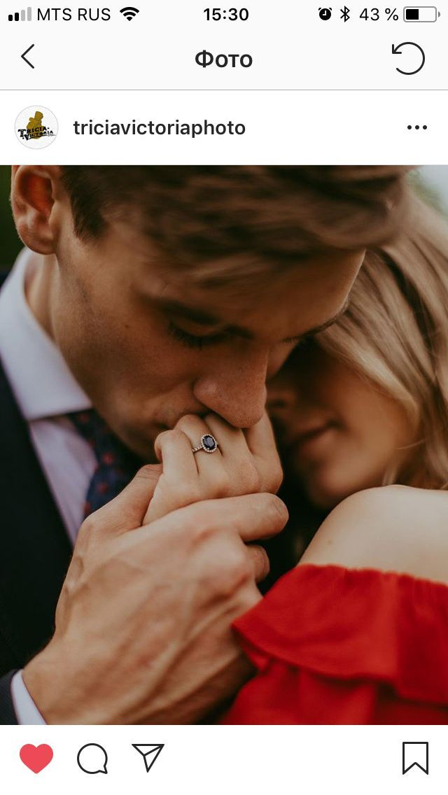 such a sweet pose for engagement photo shoot showing the ring as well