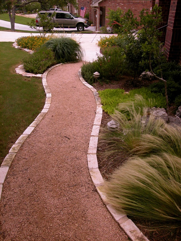 Crushed granite - like the texture and curves as well as the grasses that frame the walkway