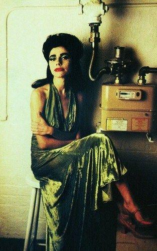 PJ Harvey Seated in a Green Dress