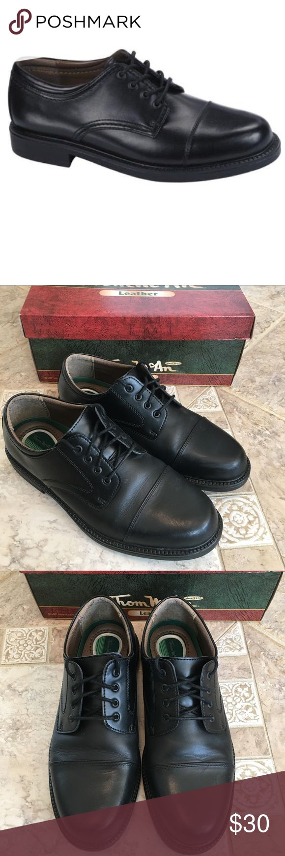 Men's black leather dress shoes Men's black leather cap toe oxford. Crafted from smooth black leather, these lace-up shoes feature a stylish cap toe and a slight block heel. Cushioned heel. Worn twice.  Excellent condition. Box included. Size 10 wide. Thom McAn Shoes Oxfords & Derbys