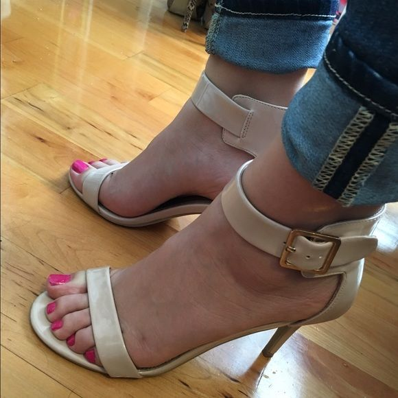 Beautiful nude patent high heels with buckle Nude patent high heels with buckle closure. Worn once for special occasion. Absolutely stunning on! Size 8.5. Would probably fit an 8 or 9 also. Shoes Heels