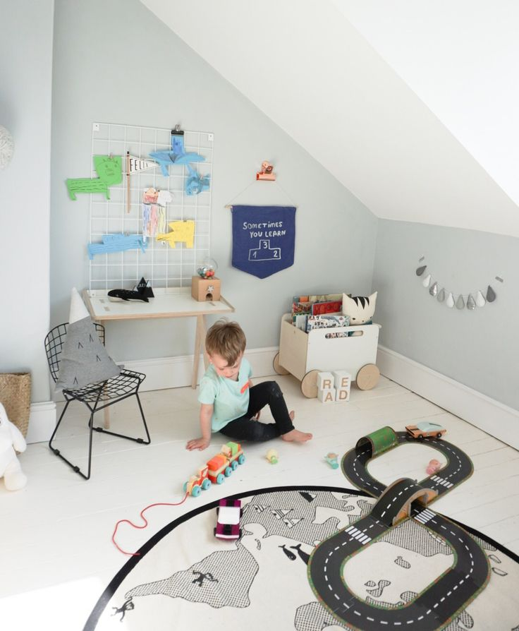 Gorgeous shared bedroom space from Coral, owner of Velveteen Babies, for her two boys. Featuring lots of small shop goodies, including some of her own garlands