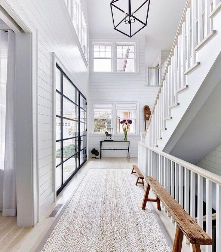 BECKI OWENS- 7 Elements of a Modern Farmhouse. Fresh white entry with shiplap and iron Darlana lantern.