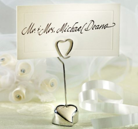 the silver heart place card holder is a unique favor for your wedding use this heart place card holder to label seats or number tables