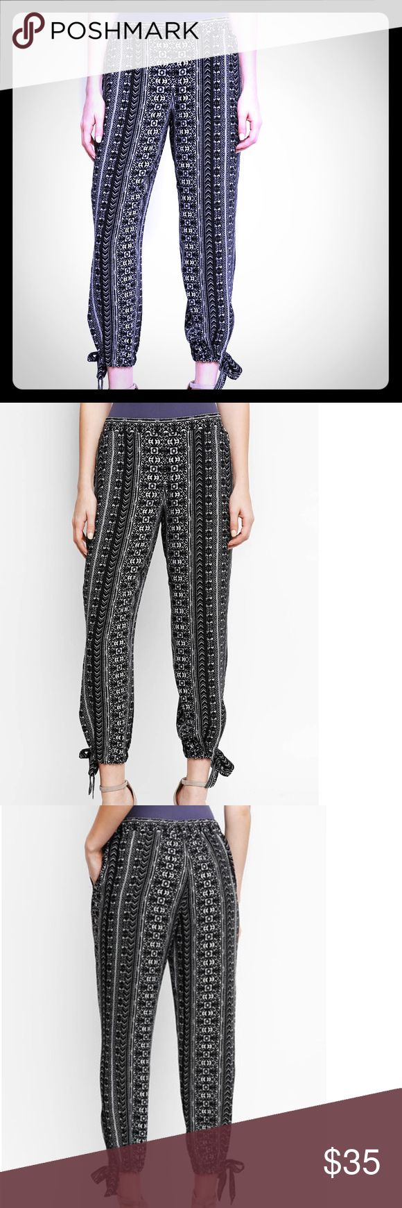 NWT: BOHO PRINT JOGGERS FROM SOUTH MOON UNDER Brand new! These pants are a super fun black & white geometric print. They are a jogger style pant with cute ankle ties.   The brand is Abbeline and they are from South Moon Under.  They are new with tags- but I have to say the tag looks battered and was obviously reattached.  I think this was done by customer service because they arrived this way when I ordered them.  I just want to mention that for full disclosure even though it doesn't matter…