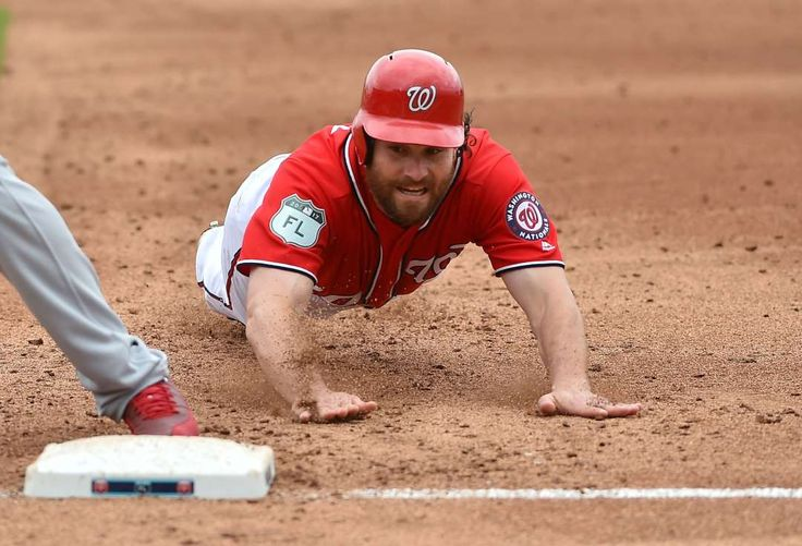 Murphy makes it back:    Washington Nationals second baseman Daniel Murphy dives safely back to the base against the St. Louis Cardinals at The Ballpark of the  Palm Beaches in West Palm Beach, Fla. March 3. St. Louis won 2‐1.
