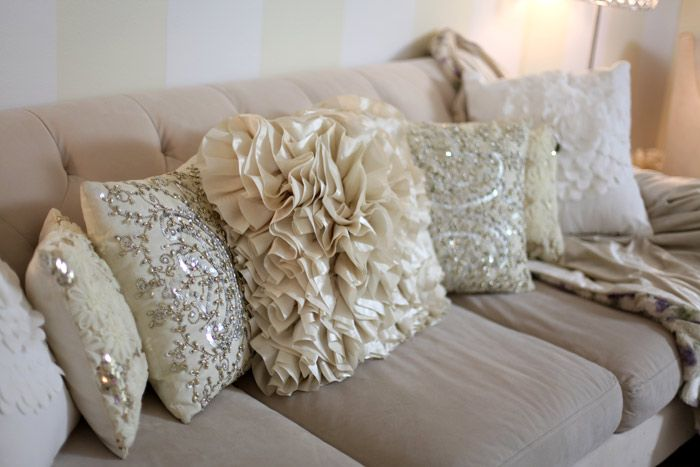 absolutely love love love all of these pillows. I have the middle one, just need the bling on the sides ;)