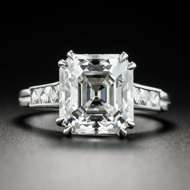 A rare and resplendent original Asscher-cut diamond (circa 1920s-30s), weighing 4.71 carats, accompanied by a GIA Diamond Grading Report stating: H color - VVS2 clarity, radiates from within a hand-fabricated platinum mounting (newly created to replace the timeworn original) modestly embellished on each shoulder with a trio of flush-set French-cut diamonds in this classic dynamic dazzler. Few come as fine or as fabulous as this chic and sophisticated statement ring. Currently ring size 6…