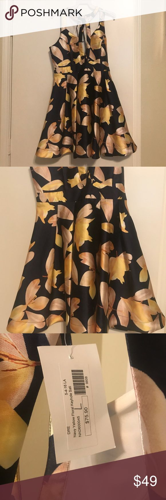 Navy Floral Keyhole Satin Dress - L My boutique navy Floral keyhole satin dress- looks and feels great. Perfect for a night out! Large Dresses Midi