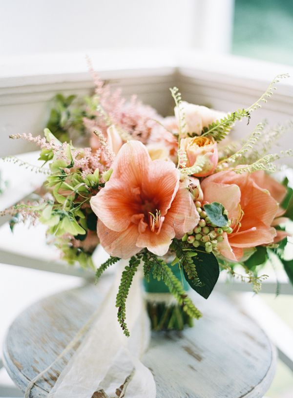 Simple and chic wedding bouquet from the gorgeous blog of @wedding chicks . This coral arrangement adds a fresh feel to your perfect day.