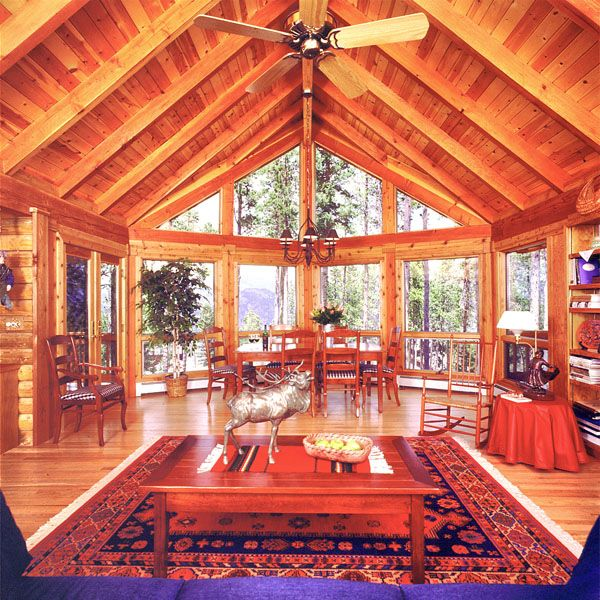 Log home great room with prow design wall of windows log for Prow style house plans
