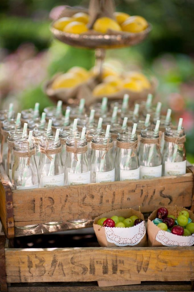 """glass """"milk"""" bottles with twine trimming and personalised sticker  in vintage bashews crates"""