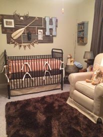 Hunting and Fishing theme nursery with Orange Diamond bumper, brown crib sheet and Gold Houndstooth dust ruffle by Pine Creek Bedding in this rustic nursery.  They used an old drawer as shelving.'