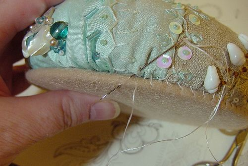 A beautiful pincushion with an old cd as the base.  Shared by ivoryblushroses.blogspot.com