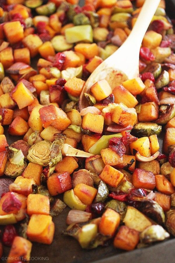 Roasted Butternut Squash and Brussels Sprouts with Cranberries, Apples and Onions – This colorful, healthy medley is so delicious, and also makes a delicious meal (or add cooked sausage). | thecomfortofcooking.com