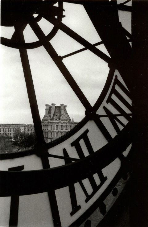 View of the Louvre in Paris through the clock in the Musée d'Orsay...the new impressionist wing at d'orsay was music to my soul.
