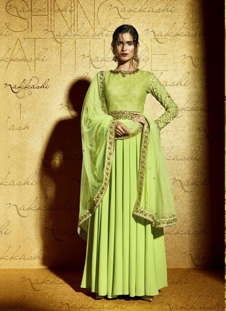 Featuring pista green embellished gown style suit intricately crafted with resham, zari and sequins work.It is paired with matching bottom material and net duppata.This outfit can be stitched upto size 44. For stitching enquiries, please email us at customercare@hunardesigns.com  |…