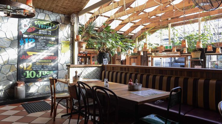 Cosy beer gardens surrounded by greenery and courtyards with comfortable chairs — here are ten bars perfect for escaping the chaos of the city.