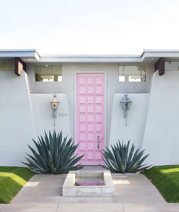 Pink door in a Palm Springs home by designer Moises Ezquenazi