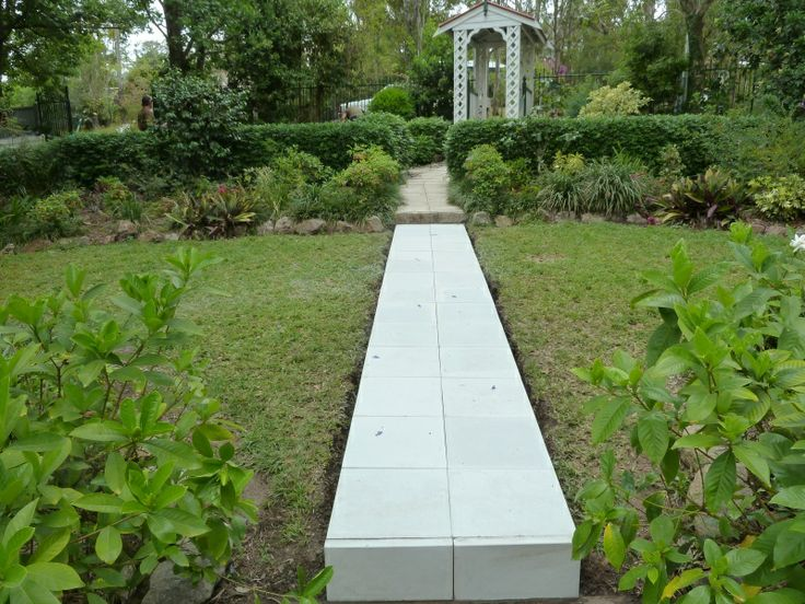 400 by 400 eden stone pavers layed on a concrete pathway to create a formal entry
