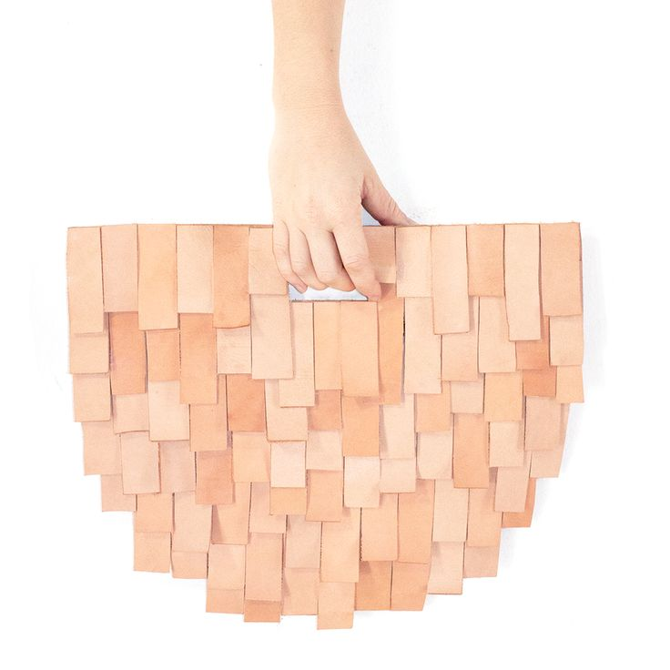 The most elegant clutch made from our tote scraps. The subtle variation in color…