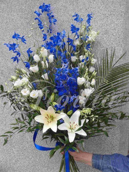 Hand-tied bouquet of lilies, eustomas and delphinium
