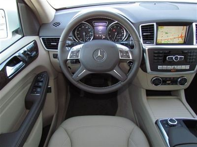 Interior of a diamond white metallic ml350 m class for Mercedes benz of chandler inventory