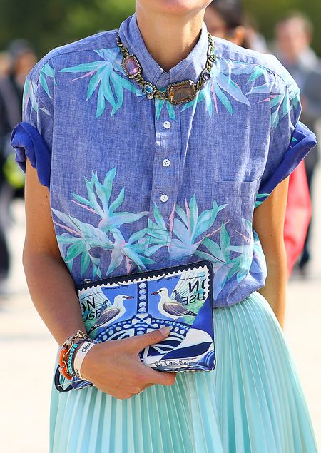 tropical palm print denim shirt. chunky necklace. clashing clutch bag. pleated skirt. Summer 2014 fashion.